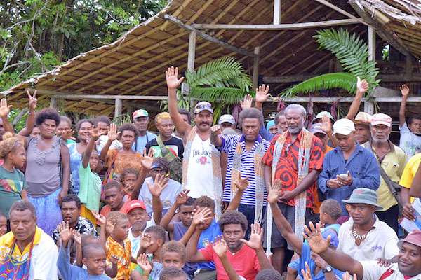 Lawrence Makili with the villagers of Bita-ama.